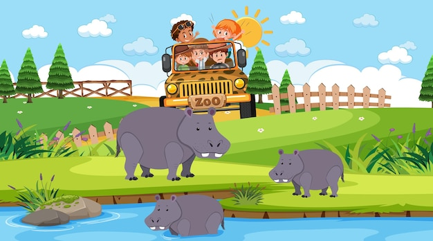 Zoológico durante o dia com muitas crianças assistindo o grupo de hipopótamos