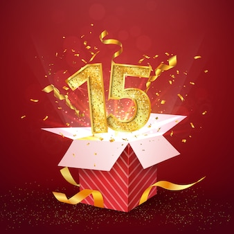 15 ° anniversario e confezione regalo aperta con coriandoli di esplosioni.