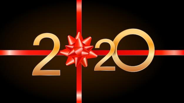 2020 happy new year con numeri dorati, nastro rosso e fiocco regalo.