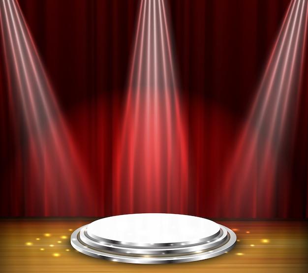 3 riflettori bianchi sul palco con sfondo rosso sipario
