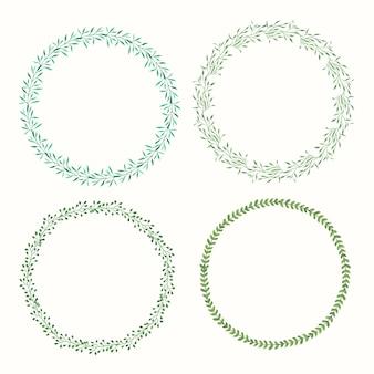 4 corone acquerello con foglie verdi e rami