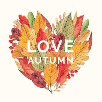 A forma di cuore con foglie e bacche di autunno