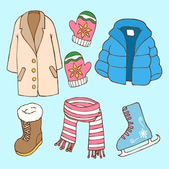 Abbigliamento invernale disegnato a mano ed elementi essenziali