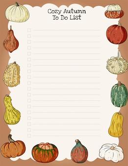 Accogliente agenda settimanale autunnale e lista di cose da fare con ornamenti di zucche alla moda.