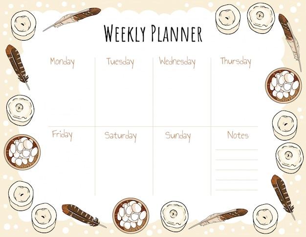 Accogliente agenda settimanale boho e lista di cose da fare con candele, piume e ornamenti di ghiaia. modello pastello carino.