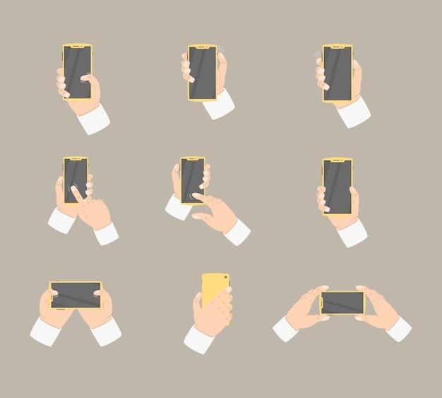 Accumulazione della holding della mano che tiene smartphone con vario stile