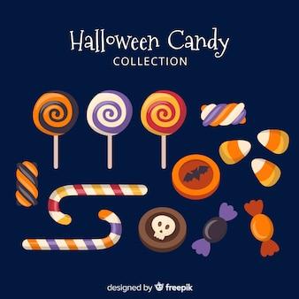 Accumulazione variopinta della caramella di halloween nella progettazione piana