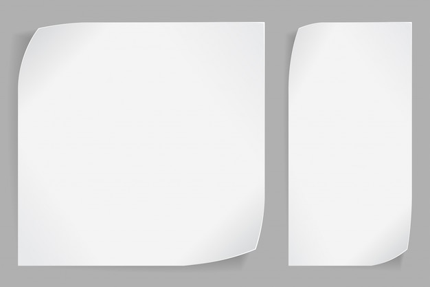Adesivi di carta bianca su sfondo grigio