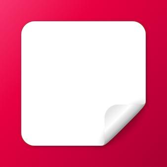 Adesivo rettangolare realistico in carta bianca con un angolo staccabile