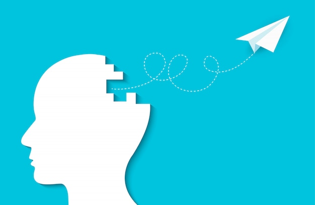Aereo di carta che vola fuori dalla testa umana, idea creativa, scintilla successo negli affari