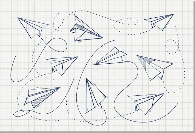 Aereo di carta origami sul foglio del taccuino