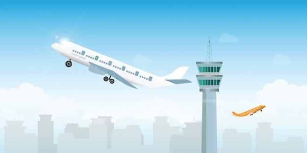 Aeroplano che decolla dall'aeroporto con la torre di controllo