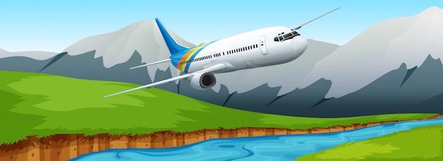 Aeroplano che sorvola il fiume