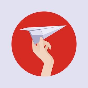 Aeroplano di carta bianca nella mano femminile