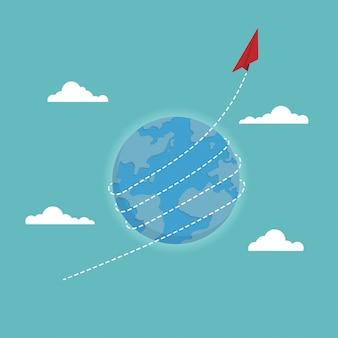 Aeroplano di carta rossa che vola in tutto il mondo