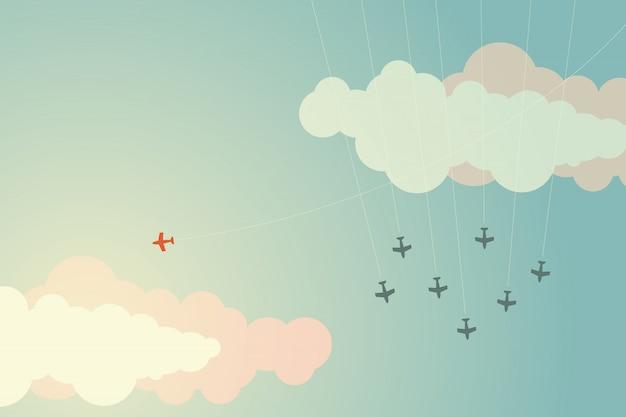 Aeroplano rosso di stile minimalista che cambia direzione e uni