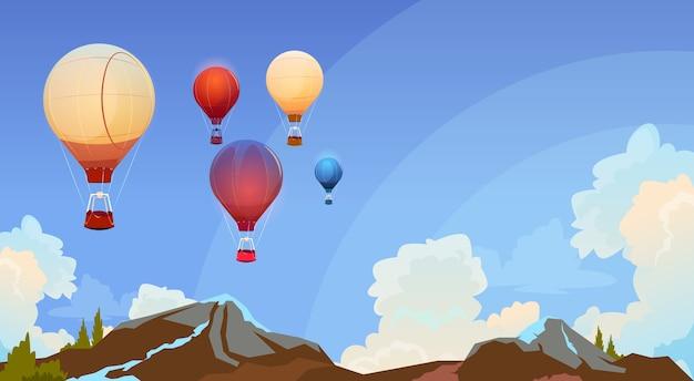 Aerostati di aria variopinti che volano in cielo