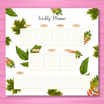 Agenda settimanale con foglie autunnali verdi