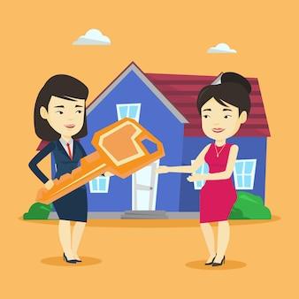 Agente immobiliare che fornisce la chiave al nuovo proprietario di casa.