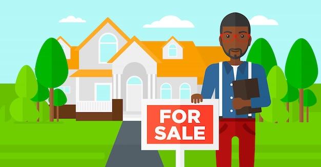 Agente immobiliare che offre casa.