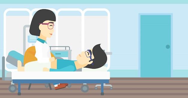 Aggiusti l'addome commovente del paziente maschio.