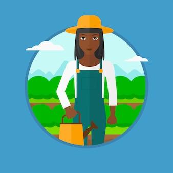 Agricoltore con annaffiatoio al campo di cavoli.