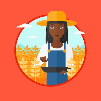 Agricoltore con computer tablet sul campo.