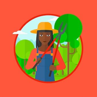 Agricoltore con pruner in illustrazione vettoriale giardino.