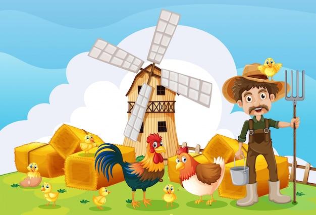 Agricoltore e mulino a vento nella fattoria