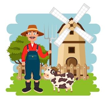 Agricoltore in piedi accanto alla mucca di fronte al mulino a vento