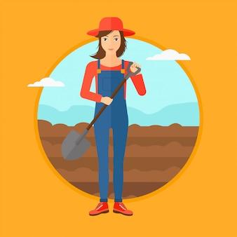 Agricoltore sul campo con pala.