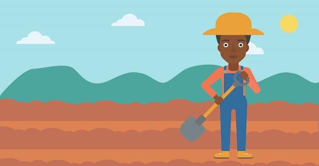 Agricoltore sul campo con pala