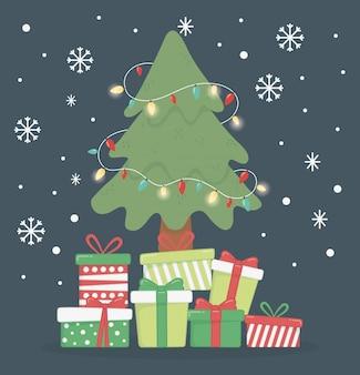 Albero con le luci e l'illustrazione di molti contenitori di regalo