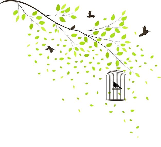 Albero con uccelli in volo