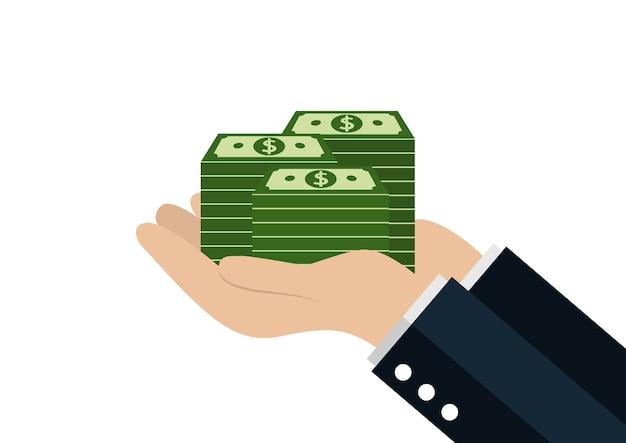 Albero della holding della mano che cresce su centinaia di dollari