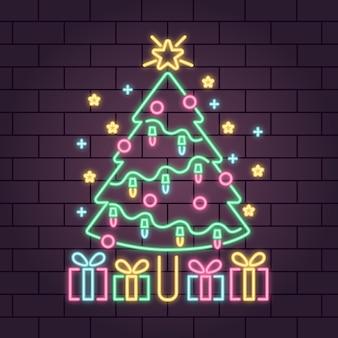 Albero di natale al neon con fiocchi di neve e scatole regalo