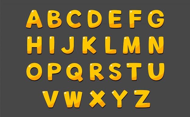 Alfabeto carino in stile cartone animato e colore oro giallo.