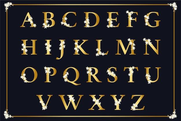 Alfabeto dorato con il concetto di fiori eleganti