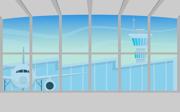 All'interno dell'edificio del terminal dell'aeroporto di partenza con l'aereo all'esterno