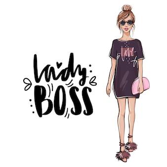 Alla moda bella ragazza in abiti di moda con borsa.