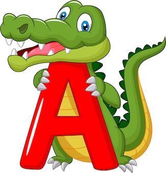 Alligatore di cartone animato con alfabeto a
