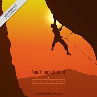 Alpinista in uno sfondo tramonto
