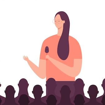Altoparlante ragazza dà un discorso al pubblico in un incontro di lavoro