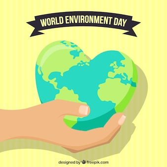 Ambiente del mondo di fondo giornata con mano che tiene globo terrestre a forma di cuore