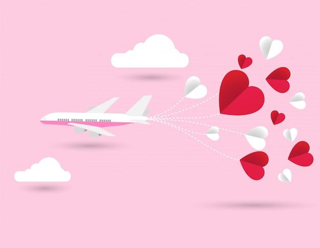 Ami l'aeroplano della carta dell'invito di san valentino e il cuore di carta su fondo astratto