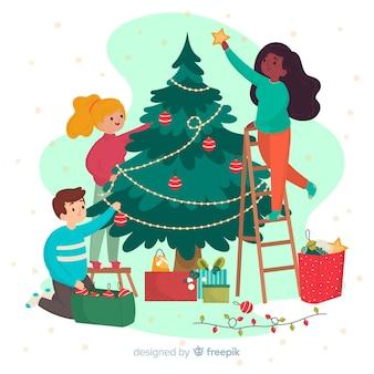 Amici che decorano l'albero di natale