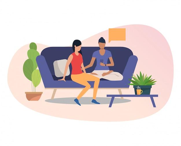 Amici di sesso femminile utilizzando smartphone insieme
