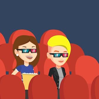 Amici felici che guardano film in 3d in teatro.