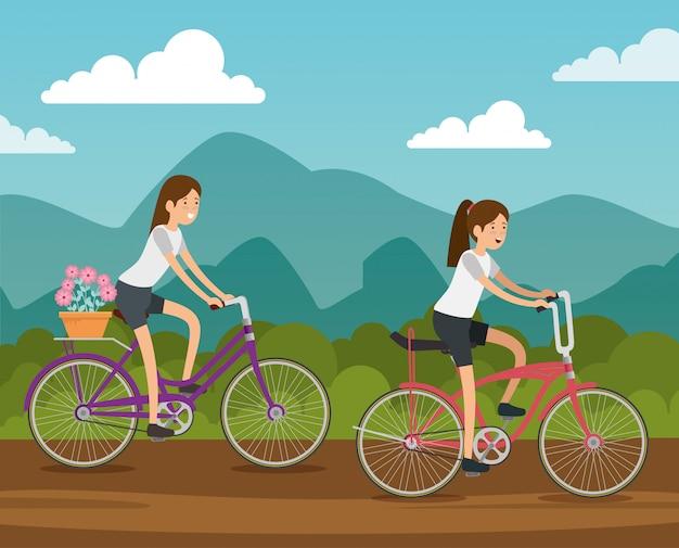 Amici in sella a una bicicletta per fare esercizio