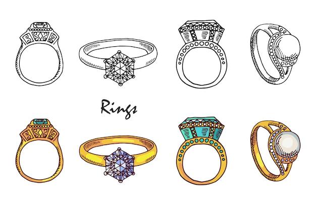 Anelli di gioielli disegnati a mano con cristalli su sfondo bianco